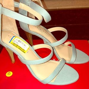 Light blue fabric heels.